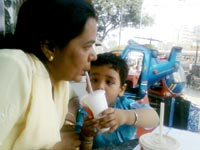 Resolution #5: Spend more time with the family - An image of Manu and Mira in McDonalds in Goregaon