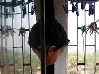 It's me...again : An image of Manu looking out of our bedroom window and his reflection