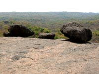 On gentle push - An image of three rocks placed at the edge at Kanheri Caves, Borivali, Mumbai