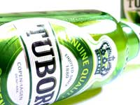 Older. Hopefully wiser too - A bottle of tuborg Beer